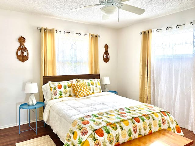 Pineapples welcome you to the second bedroom containing a comfortable queen-size bed