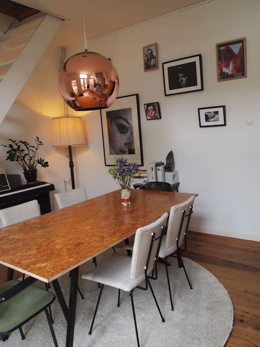Dining room with piano and art
