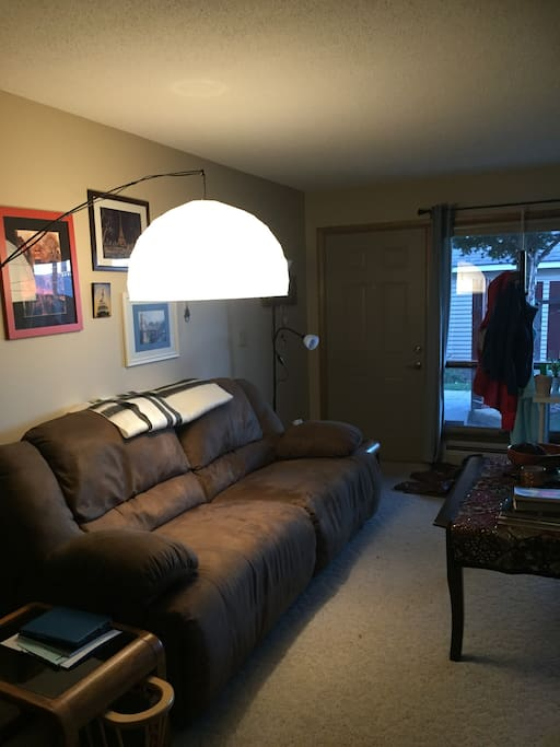 Here is another view of the living room. More photos including the dining room and kitchen will be posted on Tuesday after the apartment has been professionally cleaned. For those guest who prefer not to sleep on an air mattress, you are welcome to sleep on this couch, it is very comfortable.