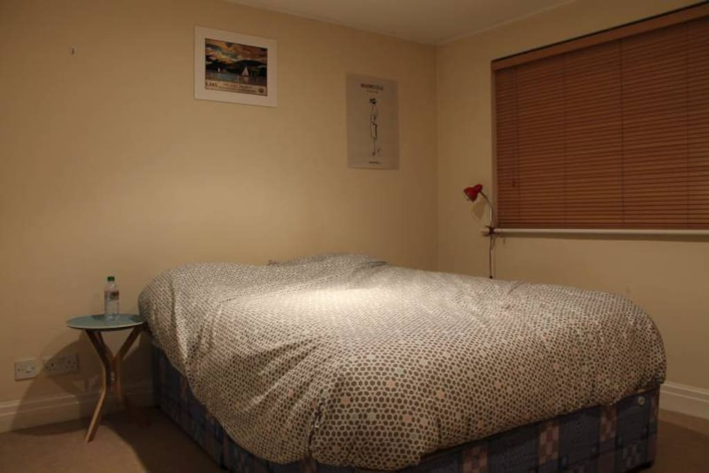 Ensuite Bedroom with double bed and balcony access.