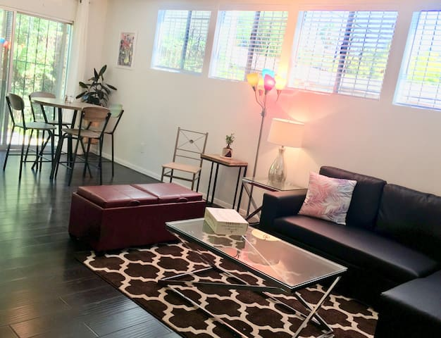 Down stairs unit open plan living room with sofa bed. Opens to a private back patio.