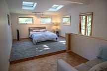Upstairs bedroom #2 with queen size bed and skylights