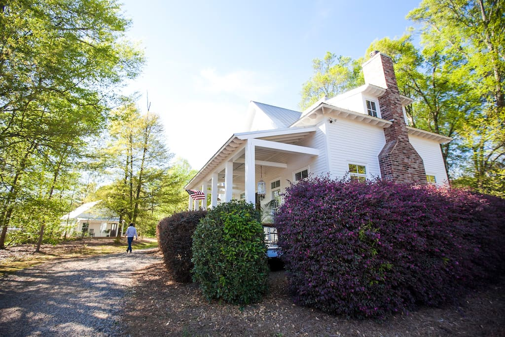 Our 1BR/1BA guest cottage is tucked away on the far side of our 1 acre lot - the entrance is private and completely separate from our main residence. Here you can see the carriage house as well as our home.