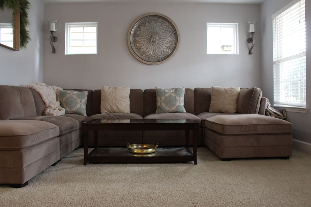 Cozy Living Room - moveable sectionals to turn into a bed!
