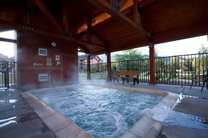 Hot Tub!  Pools Galore!  Firepits! Ski Shuttle!!