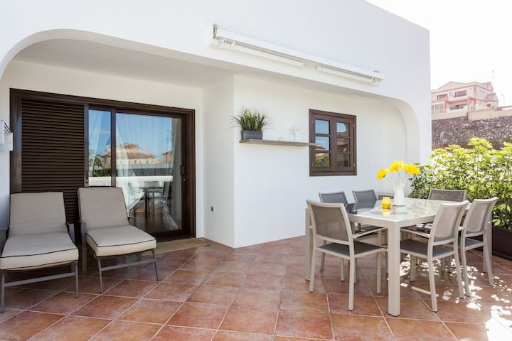 sunny terrace with table and 6 chairs where you can eat and relax while  enjoying a great ocean view