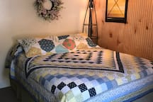 First Floor bedroom has a queen bed sleeps 2 people. Bed is made up with clean linens & comforter for your arrival.
