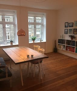 This charming apartment has one bedroom,  two big bright living rooms (with room for a temporary bed), a small nice kitchen with everything you need and a big bathroom. The apartment is located near the metro station Fasanvej, Frederiksberg garden, shopping mall, supermarkets - everything you need!