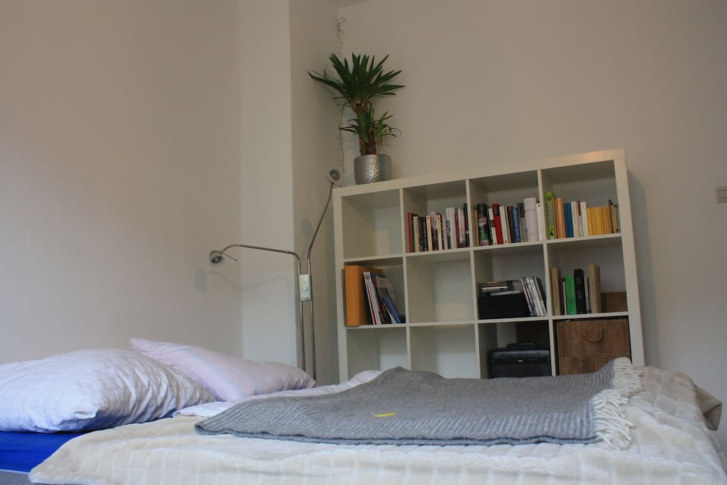 The bed with the bookshelf