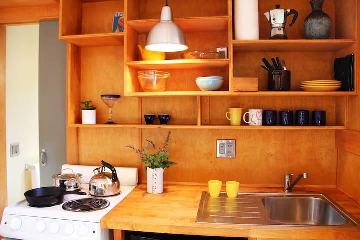 kitchenette with stove & fridge