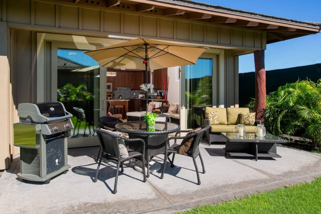 Barbecue grill and outdoor living/dining area.