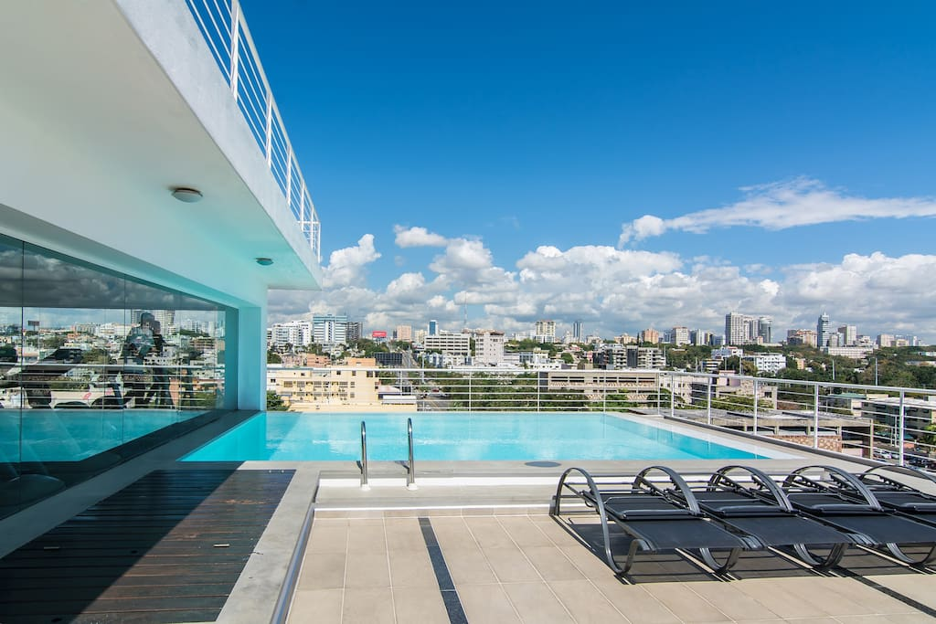 Shared rooftop terrace with pool, Ocean view, City view, lounge chairs and sundeck