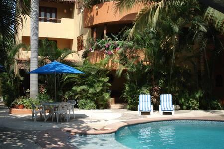 Beautiful Pool Side Condo-  Ground Level