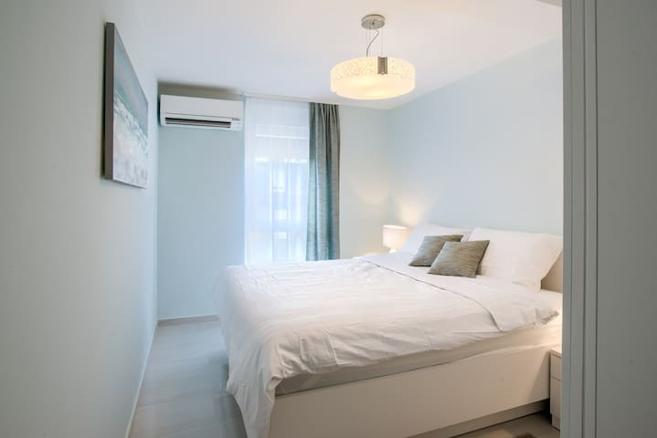 Bedroom with separate air conditioning unit