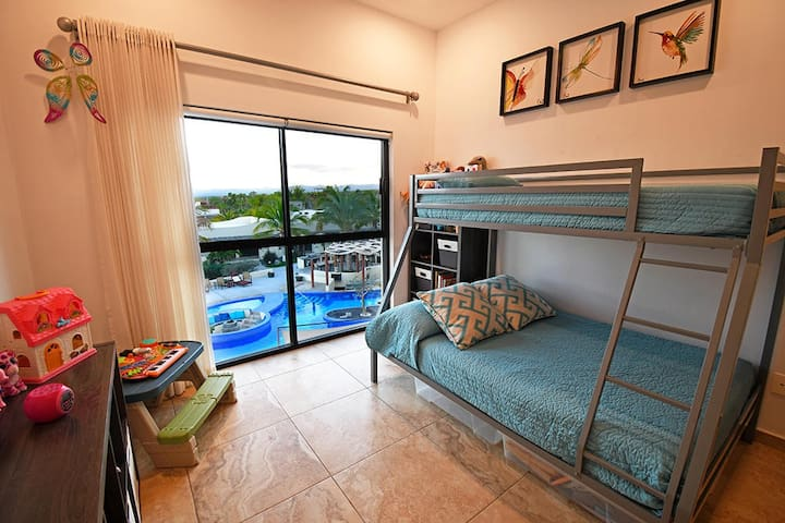 Second bedroom with views of swimming pool