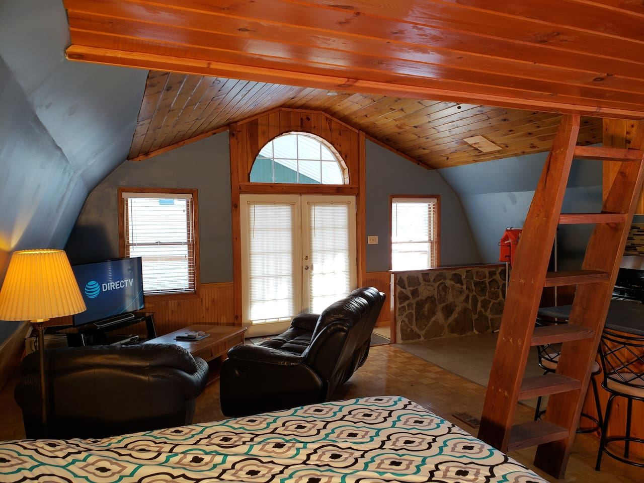 Leather sofa and reclining chair including smart tv and DIRECTV.  Lake with paddle boat, kayaks, and even a weight room is included with your stay.