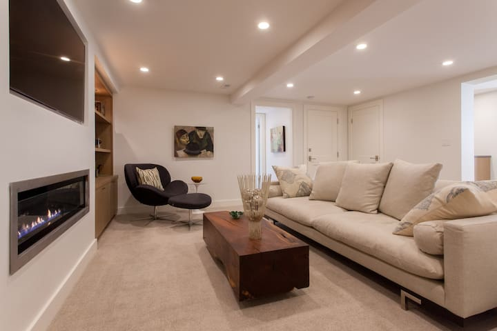 This is your private living room. It is much more than just a room.  It is an entire floor 800 square foot sweet privately set on its own lower level of the home.
