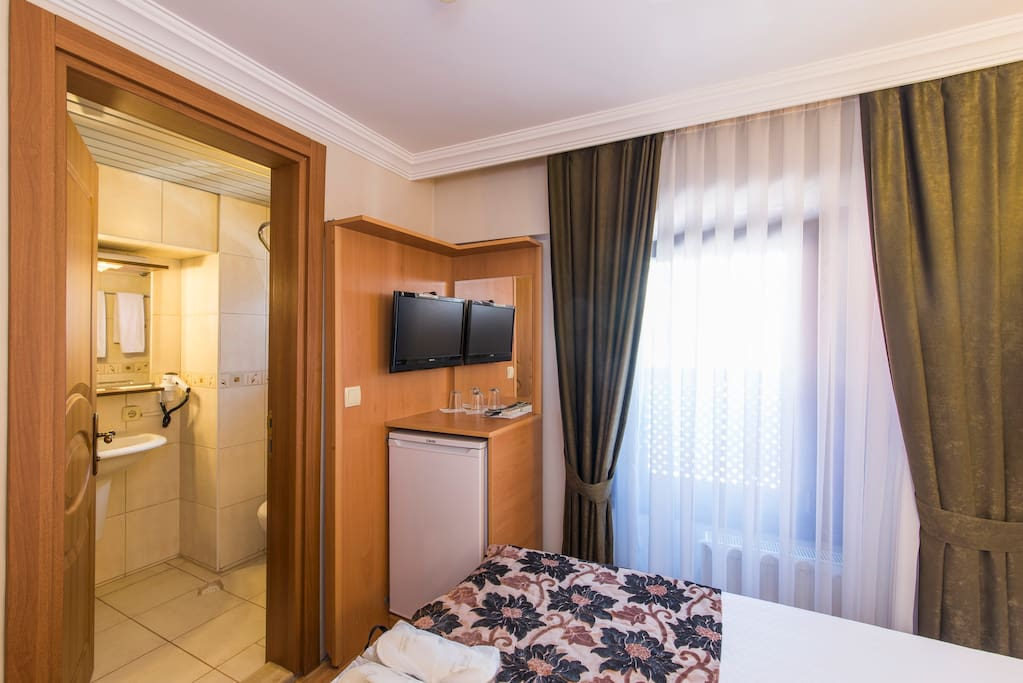 A minibar supplied with complimentary water & mineral water. LCD TV with international satellite channels, bedroom slippers and standard toiletries, a hair dryer & free Wi-Fi connection. Daily cleaning. Laundry & Ironing service for a small extra cost. Non-smoking rooms. Charming street view...