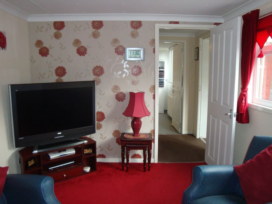 """Living area has a 42"""" TV with Sky TV, a DVD Player with films plus a CD player with an assortment of CD'S"""