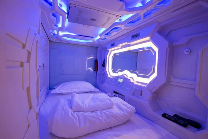 Area 24|7 capsule hotel. Capsule in Male dormitory