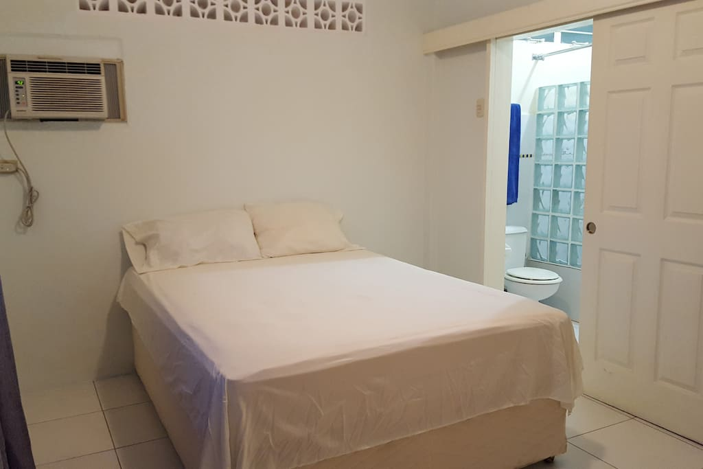 Airconditioned Master Bedroom with ensuite bathroom