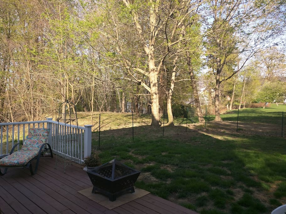 Cozy deck and wooded view with propane grill