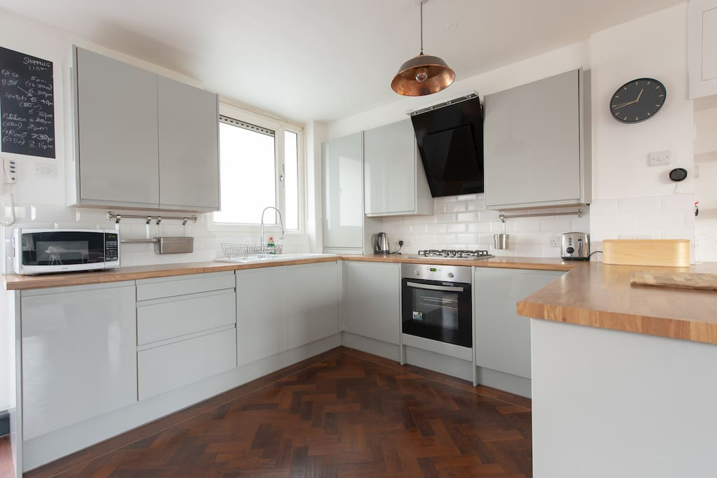 the kitchen includes a dishwasher, washing machine for clothes, cooker and gas hob, and a fridge and freezer