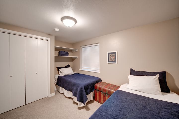 Two twin beds in lower-level bedroom
