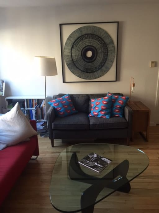 Furnished living room with comfy couch & pillows