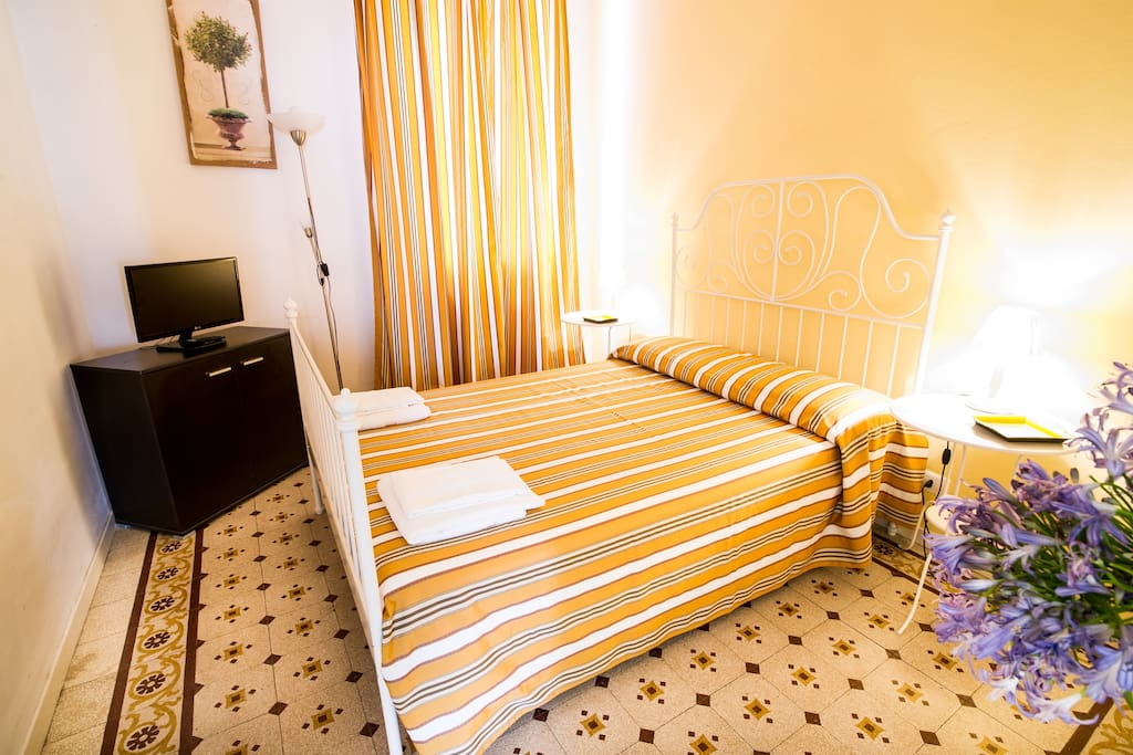 Have a relaxing sleep in this double bedroom .. Watch some Italian Tv before sleeping ;)