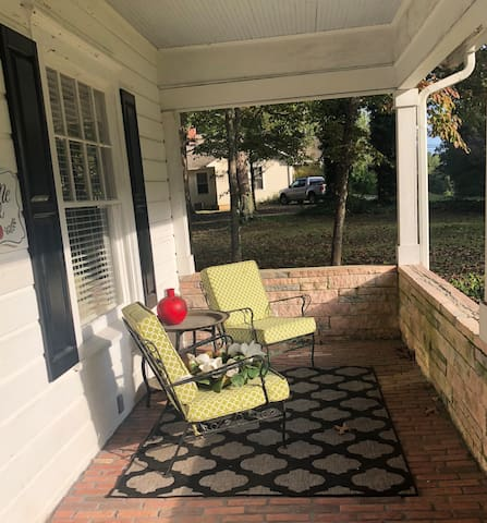 Front porch sittin' with a cool drink or warm coffee. Perfect morning sun or evening moonlight.