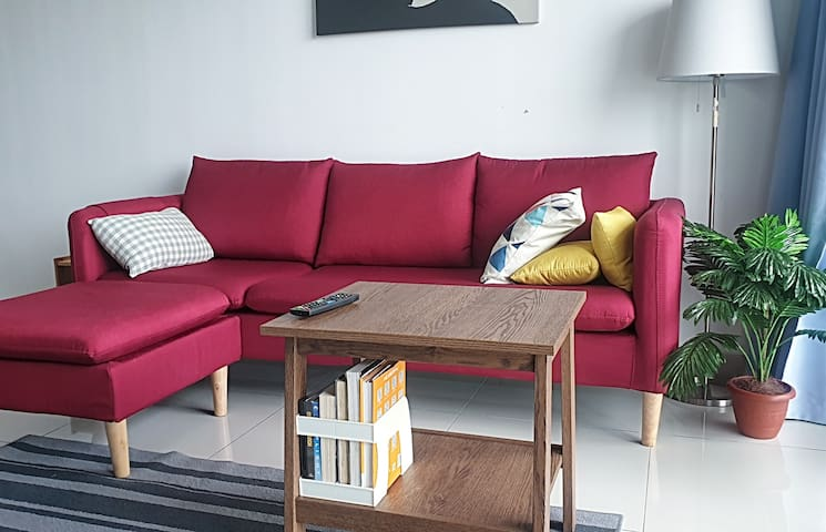 Living Room with 3 Seater Sofa in Red Colour.