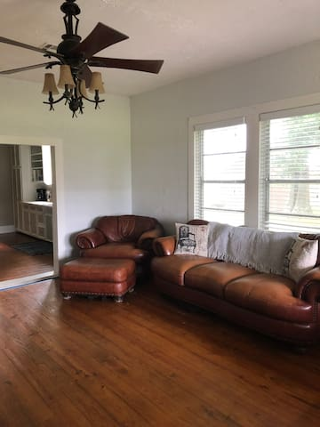 Large Living Room with original hardwood floors throughout house