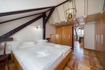 An exquisite mixture of different woods and a welcoming double bed.