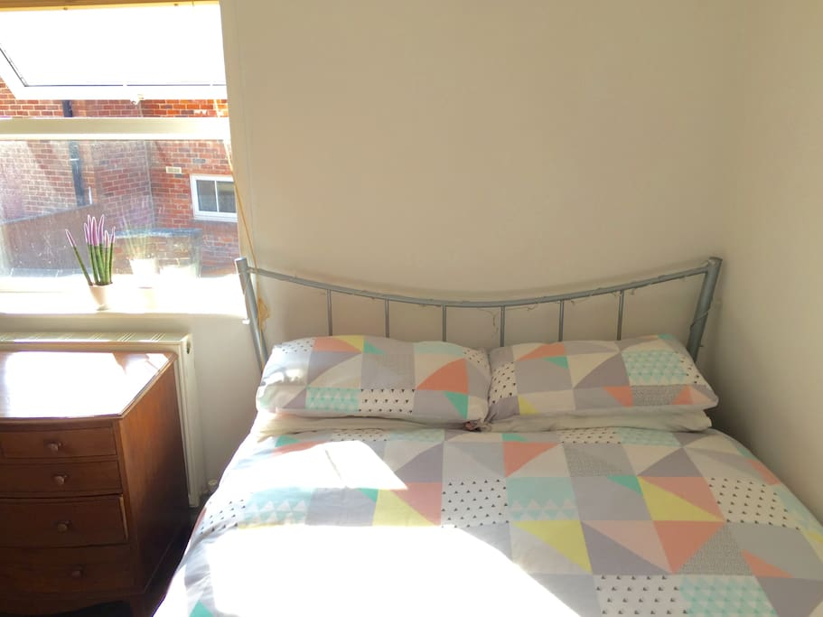 Bright and sunny bedroom with comfortable double bed