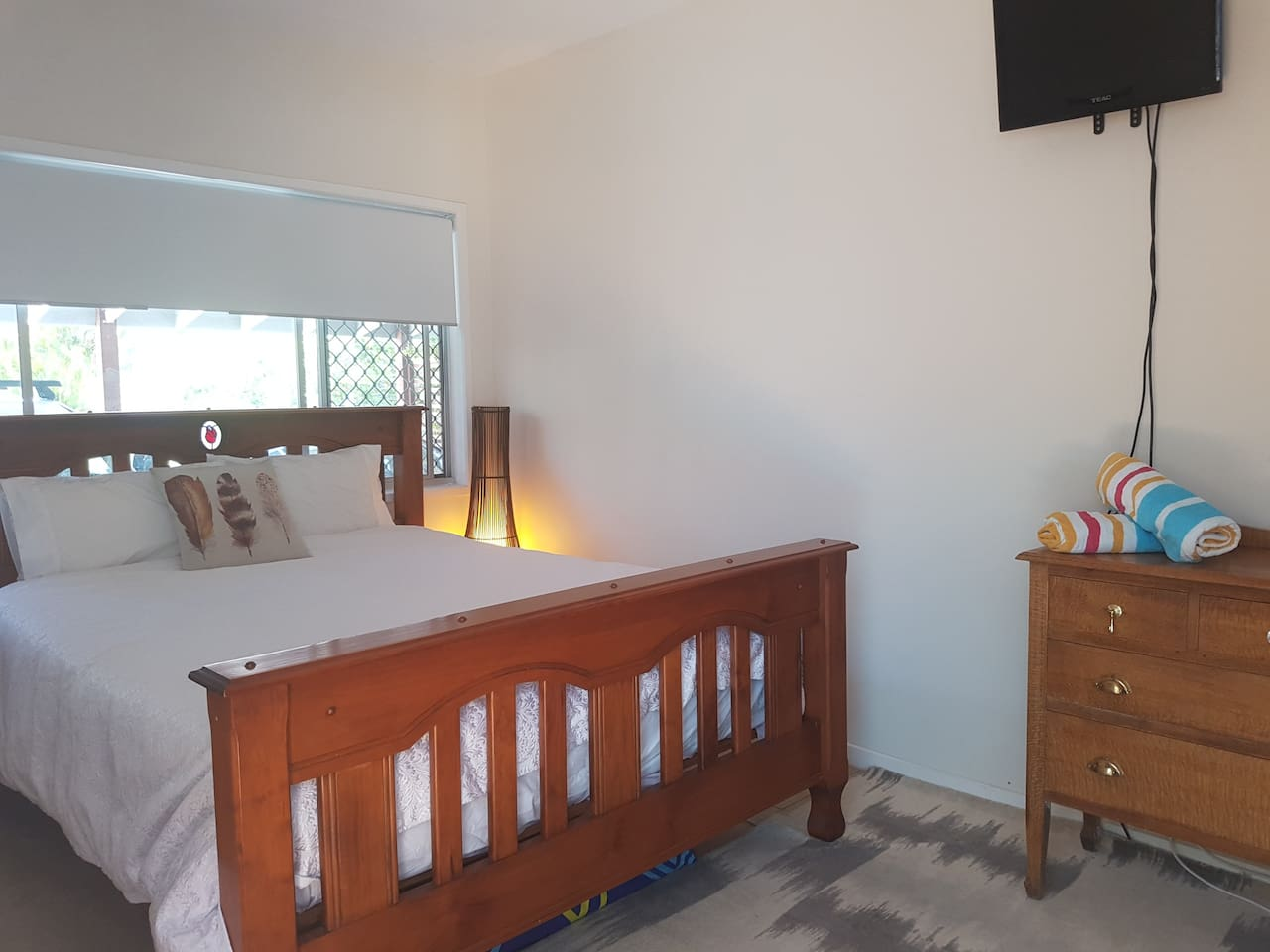 Private room with a comfortable queen bed and television.