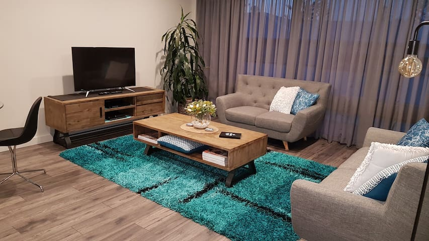 Comfy lounges, flat screen TV, PS4 and DVD player