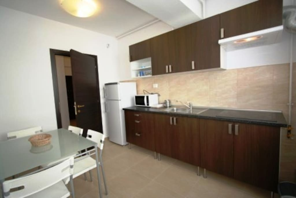 The kitchen is fully furnished and equipped.