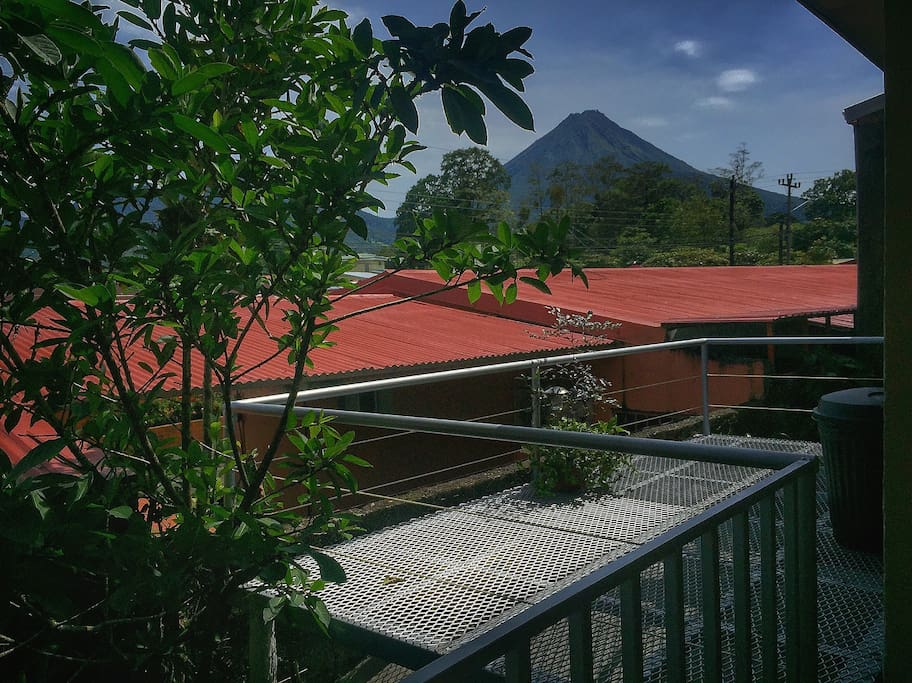 Backside terrace with amazing volcano view. Perfecto for enjoying a nice sunset or a delicious breakfast; it features table chairs and charcoal BBQ grill.