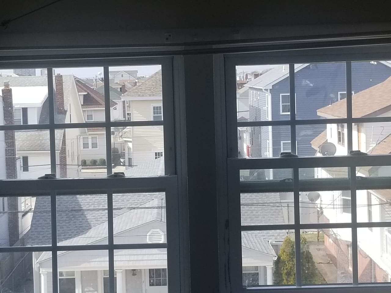 Two giant side by side windows overlooking beautiful ventnor city