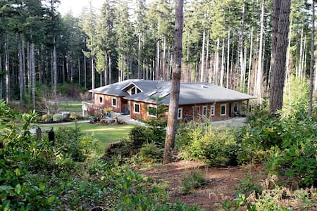 Coastal forest home with garden setting