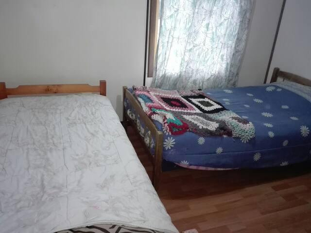Pieza compartida camas individuales