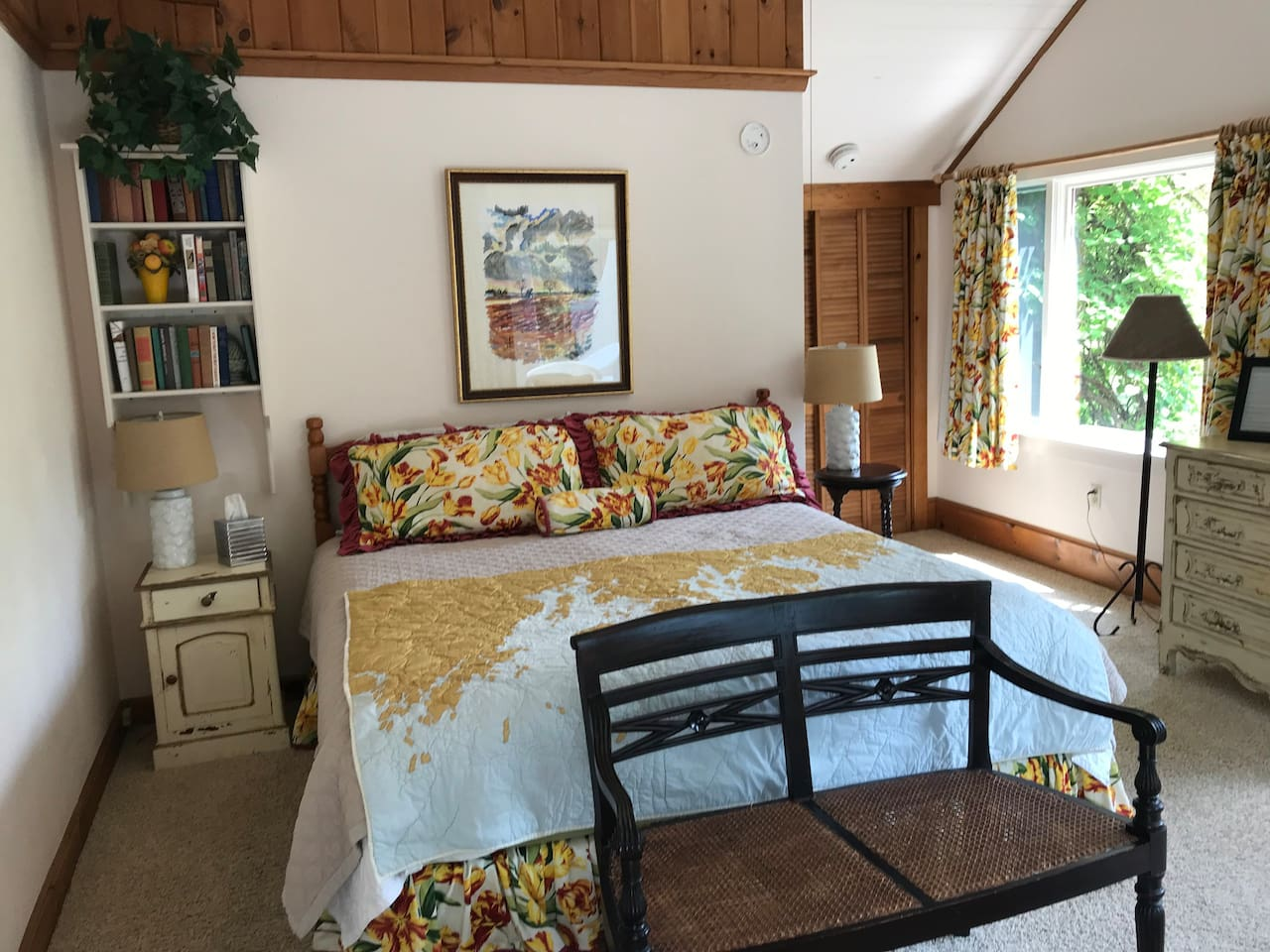 Room 1 with a king bed covered by a handmade quilt of the Maine coast. Comfy!