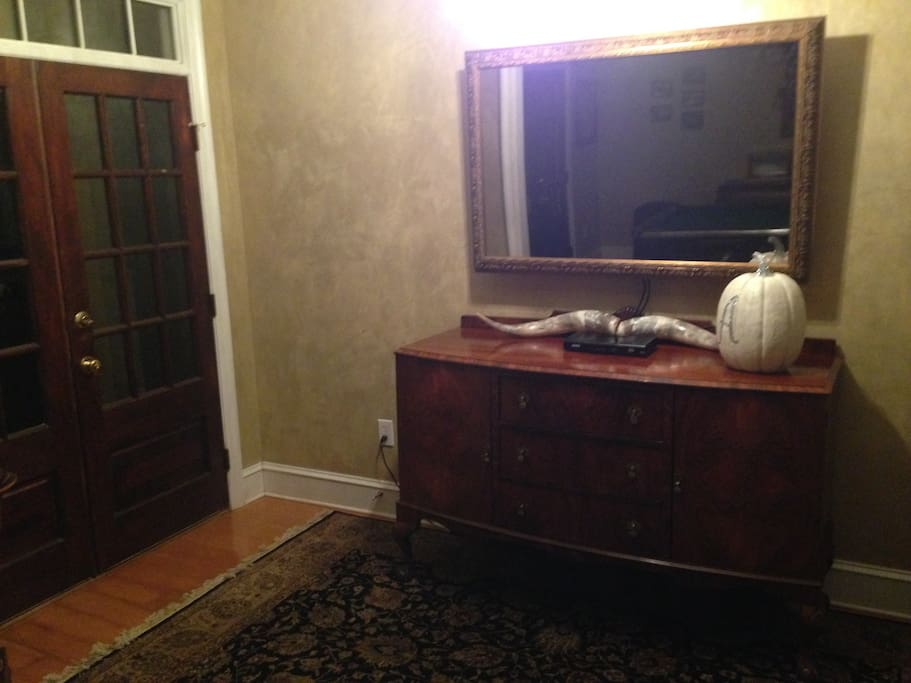 Foyer with mirror/tv
