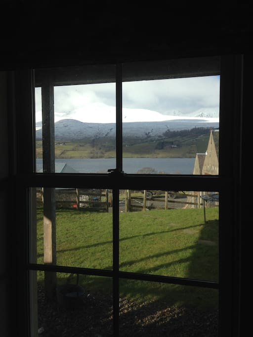 Spring view from the bedroom to Loch Tay and snowcapped Ben Lawers