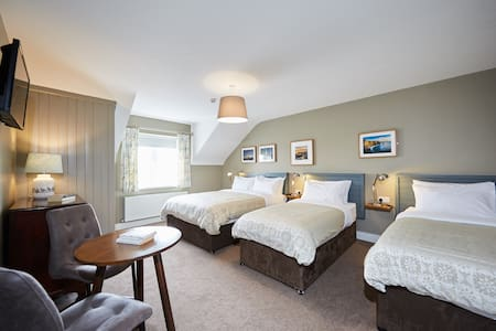 Our 4 Bed Family Rooms are large, bright and spacious and come in various styles, all with a private bathroom.