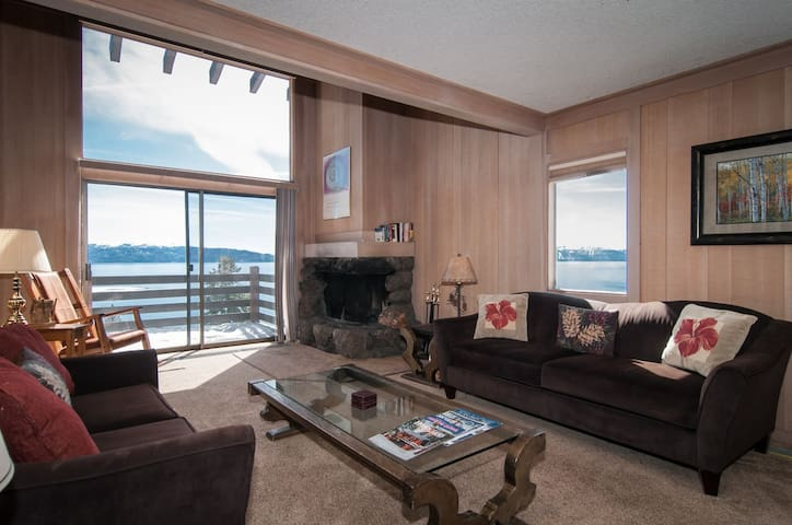 all new living room furnishings and blinds in the great room.  corner wood burning fireplace and big windows to take in the amazing views