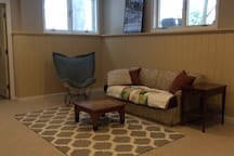 Finished basement with pull-out couch and television
