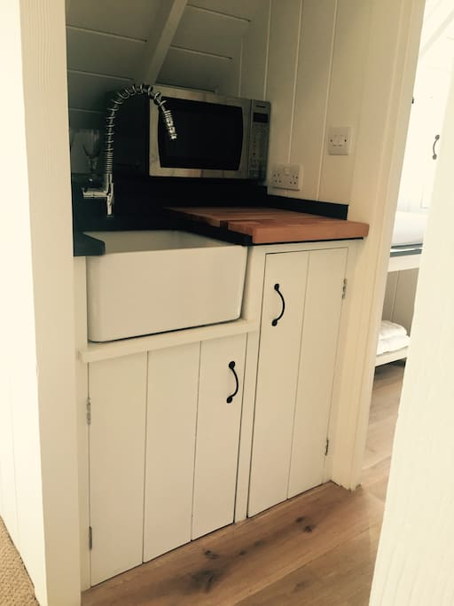 Galley kitchen w/ microwave and convection oven etc.