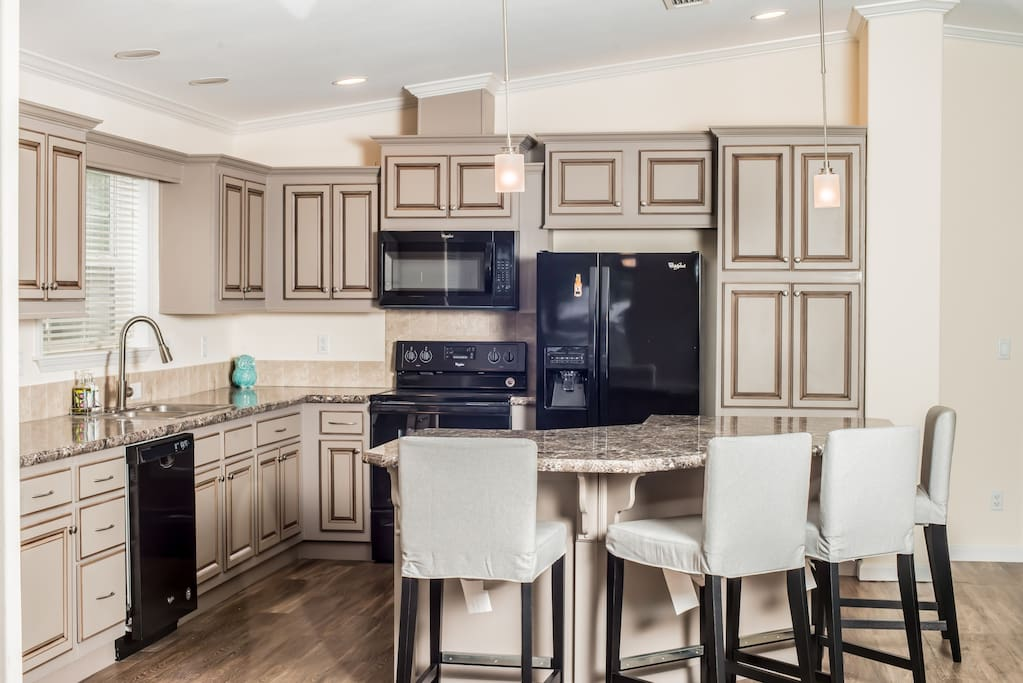 Enjoy our beautiful kitchen with marble countertops and new appliances, which comes fully stocked with cooking utensils and much more!